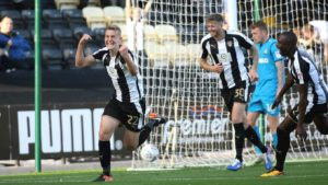 Ryan Yates sets off in celebration for Notts County